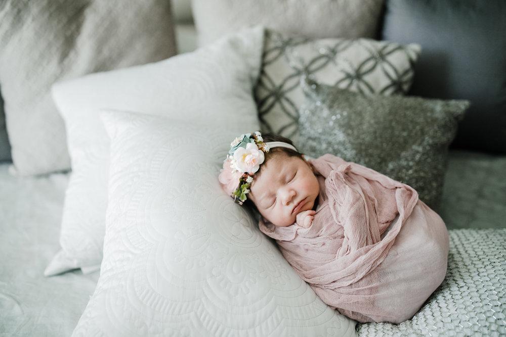 2018(C)JGP_jennygrimm.com-chicago-lifestyle-family-photographer-newborn-pink-bedroom-white-flowers.jpg