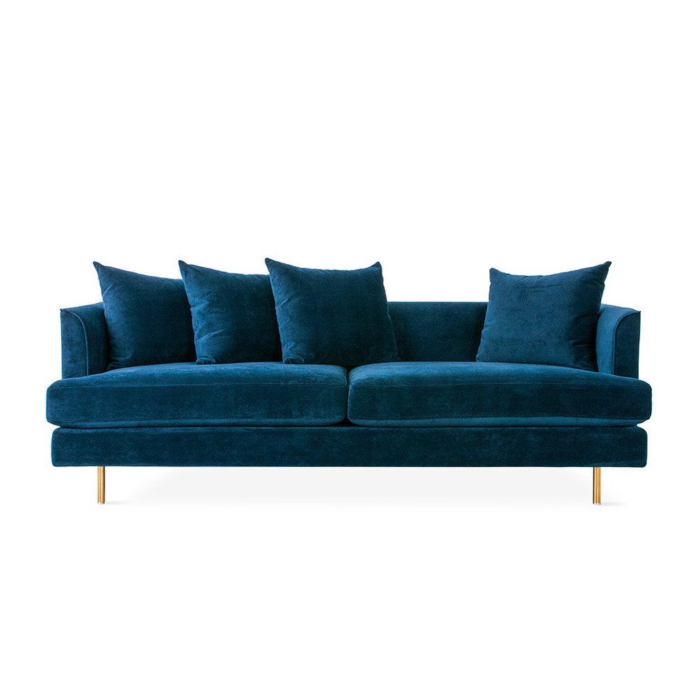The Margot Sofa epitomizes modern elegance with graceful arms, French-seam detailing, and loose, luxurious cushions that give a look which is both timeless and contemporary. Every sofa includes two sets of cylindrical steel legs, allowing you to choose between a brass or black finish to suit your style. The seat and back cushions use a unique, eco-friendly synthetic-down, derived from recycled PET plastic. The frame is constructed with kiln-dried 100% FSC®-Certified hardwood