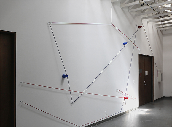 Picnic, 2014 Bungee cords, plastic cups, and hardware Dimensions variable