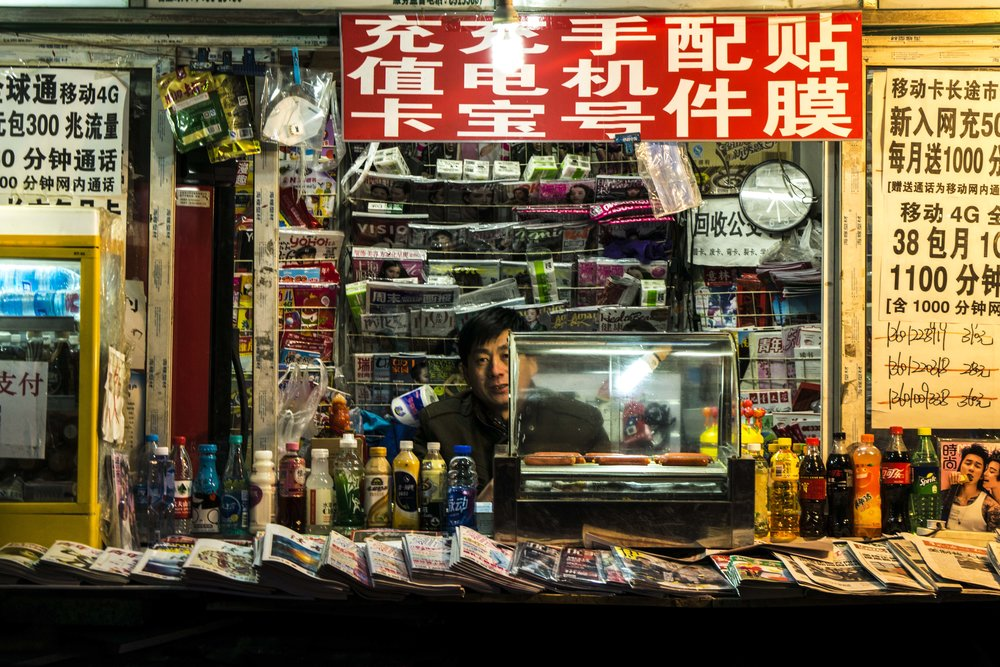Newspaper Stand at Night