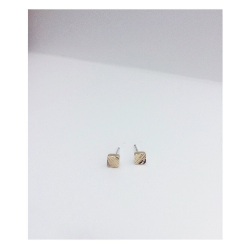 recycled gold studs to match a custom wedding ring