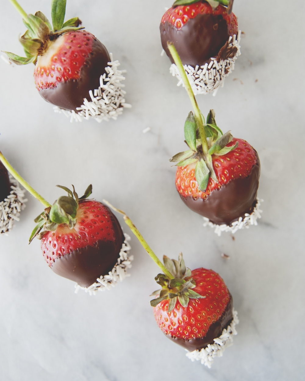 chocolate dipped strawberries with white chocolate sprinkles