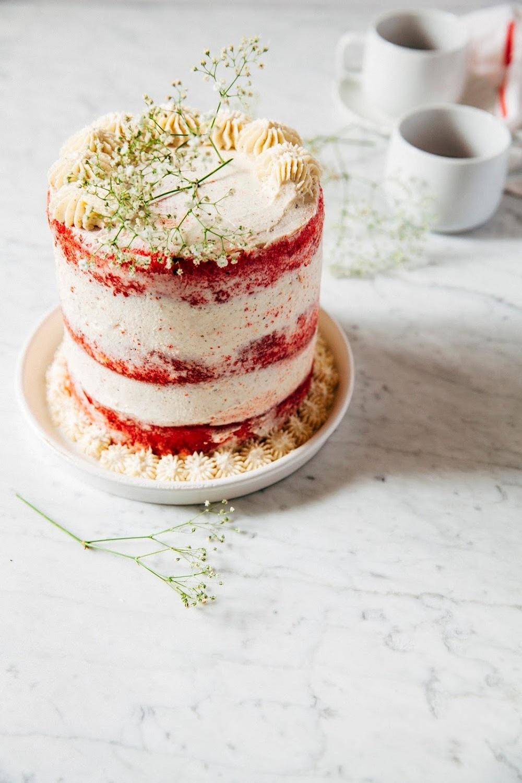 a naked red velvet cake with crème fraîche frosting