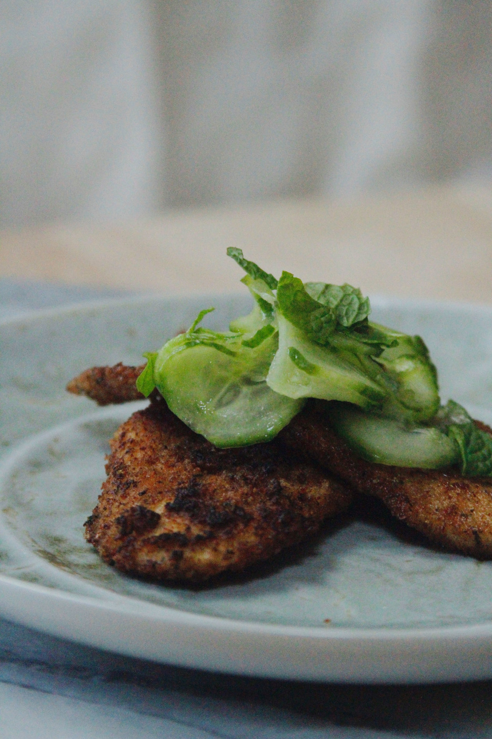 five-spice chicken and pickled cucumbers