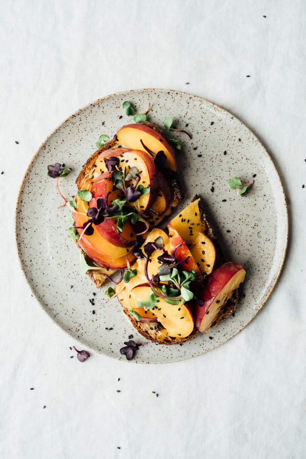 Toast with peaches, tahini and honey