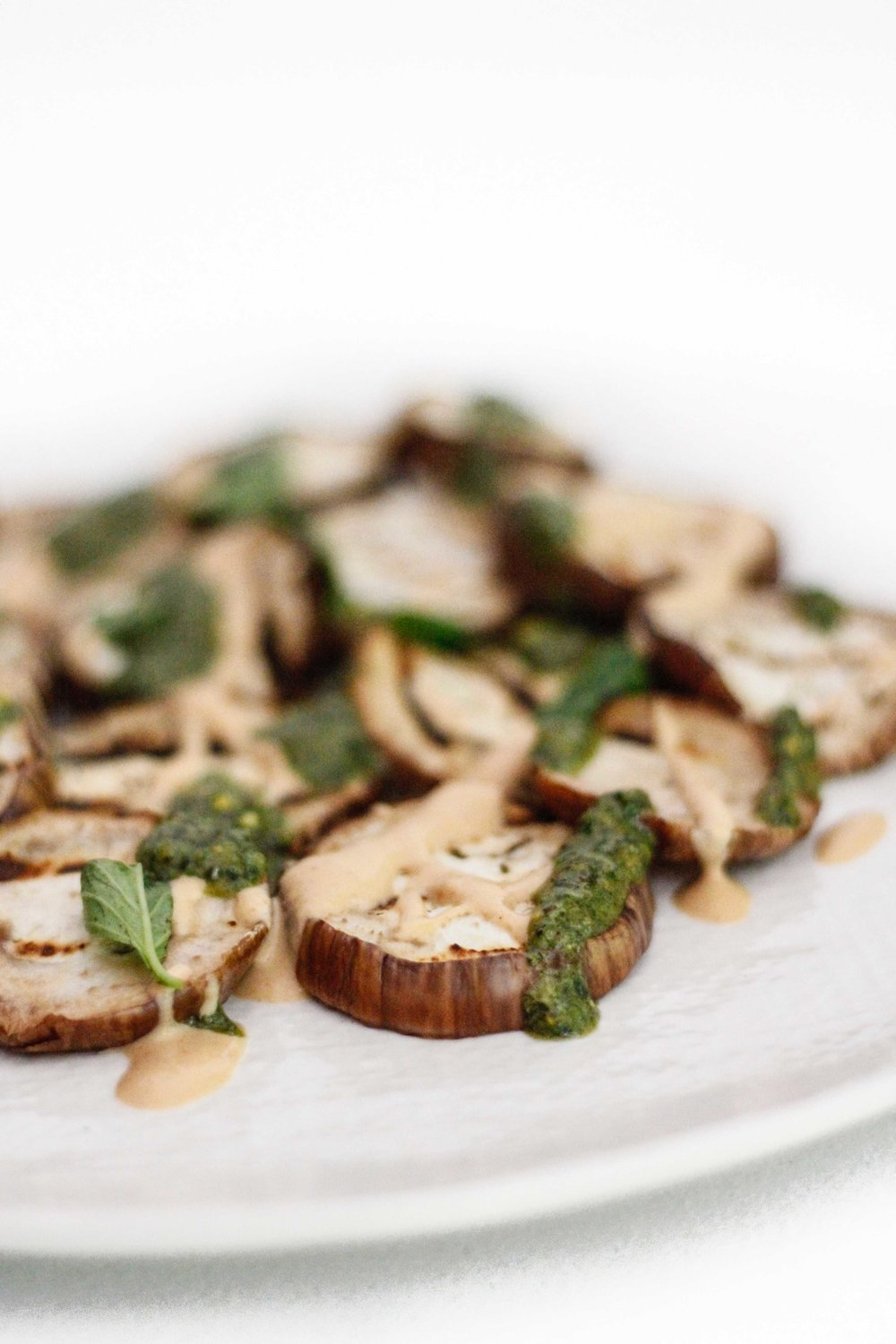 Grilled eggplant with spicy tahini and pesto