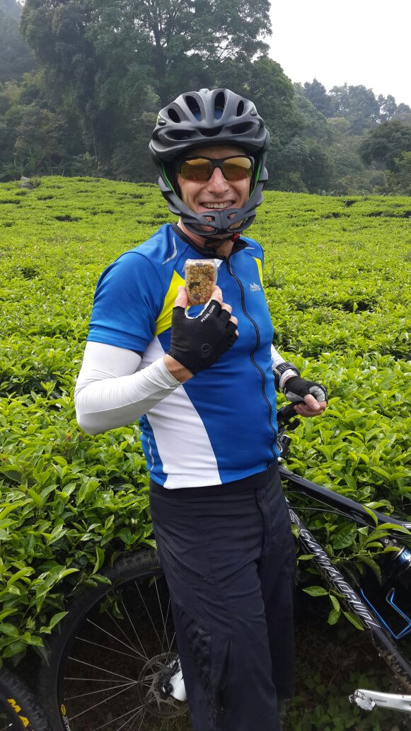 """""""Mountain biking in a West Java tea plantation. COULDN'T HAVE DONE IT WITHOUT NUTS AND GLORY! Thank you, Clotho....""""-- Rory, Jakarta, Indonesia"""