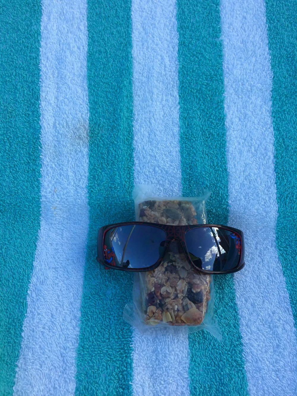 Sana from Houston, Texas sent this photo from her vacation on Paradise Island inBermuda. Stripedbeach towel, Spidey shades, Nuts and Glory granola bar....paradise!!