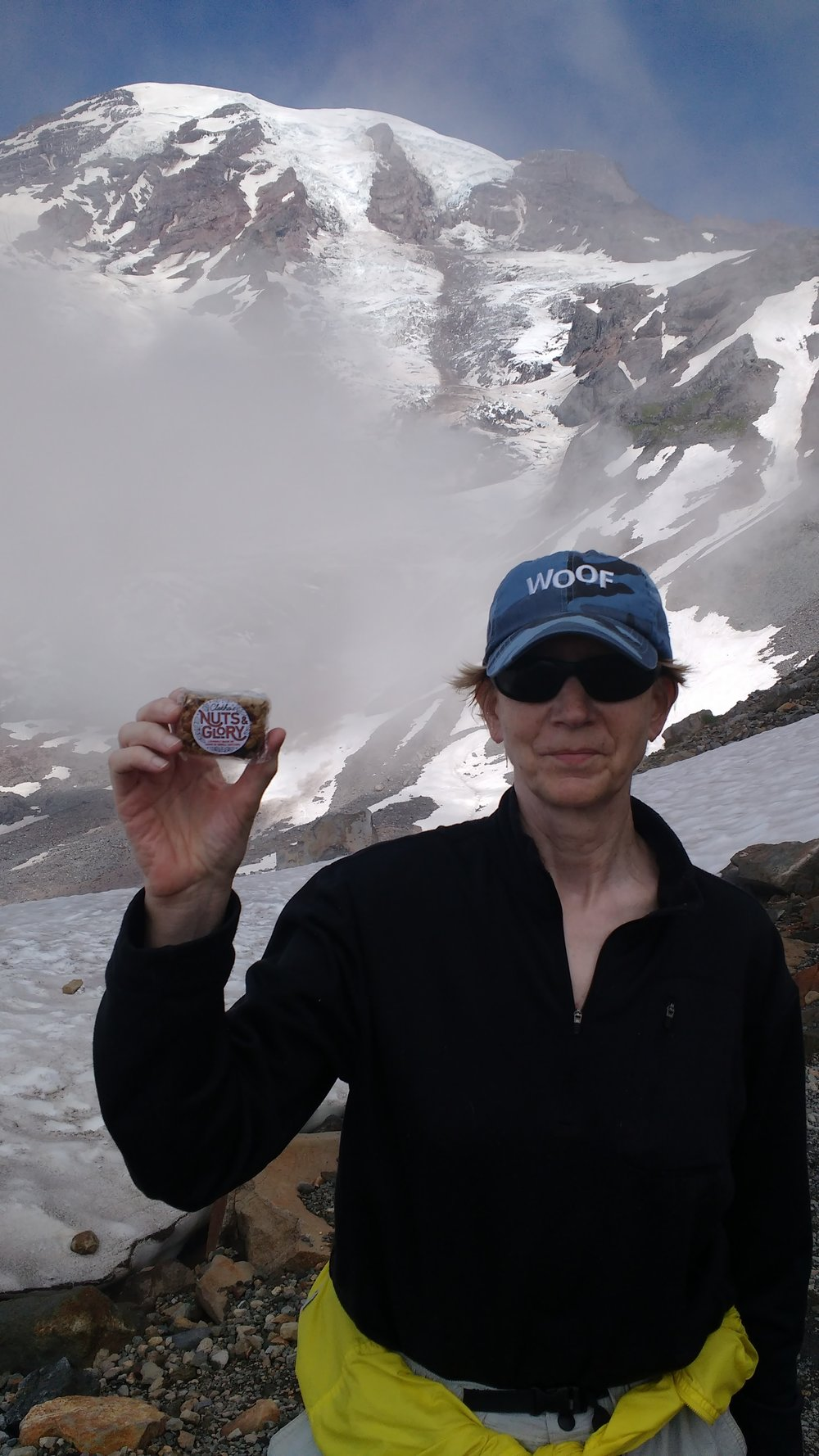 """Amy, an amazing cyclist, 9-time cancer survivor, and a veterinarian from Connecticut (hence the """"Woof""""hat), shared this photo from a hike on the Skyline Trail in Mount Rainier National Park."""