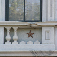 Bronze stars mark the scars on the State House left by union armaments during the shelling of Columbia.