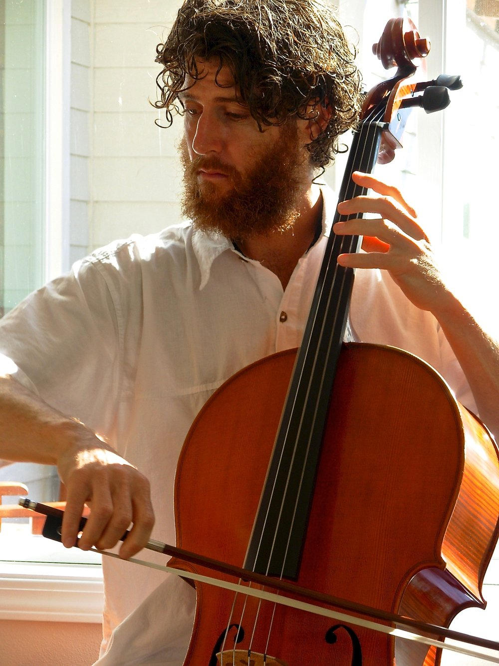 Andy Rising, Cello - Andy Rising took up the cello at 11 years of age. The sound and dynamics of the cello captured his interest after listening to a record of Rostropovich performing the Dvorak Cello Concerto. Ever since that day he was loaned a Cello from Eisenhower Middle School in San Antonio Texas, he could hardly stop playing it. He has had many great teachers: his first from the San Antonio Symphony (Annett D'Giocia), and one 0f his last is a renowned international performer (Yehuda Hanani).Andy was born in Kealakekua, Hawaii. Water has been part of his life and inspiration. After all, music is a collection of waves! The ability to ebb and flow, like the living waters, was borne of his Hawaiian upbringing and speaks to his bowing technique and compositions. Andy is a composer who has traveled to many National Parks and spent many a month in the great outdoors where much of his music is dreamed up. Andy loves to improvise and create the song of the moment. He also loves Classical music- with the amazing breadth of emotion and communication it brings to us, along with its ability to connect centuries and generations.