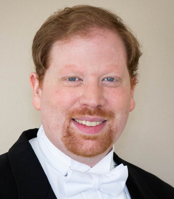 John Fitzgerald, Music Director, Conductor of Youth Orchestra, Voice + Piano - John Fitzgerald, Lyric Baritone-John is from Monterey California, but he grew up in Scranton Pennsylvania. Before moving to Sandpoint Idaho, he received his Bachelors of Music from Westminster Choir College and his Master of Arts in Teaching from Rider University. John has performed extensively with choirs in both New York and professional recordings in Philadelphia. John has been an artistic director and instructor in numerous programs in the North East Pennsylvania area.John has sung with several opera houses across PA including PA Lryic Opera, Amici Opera, and Seabrook Opera, and he performed the roles of the Major General in Pirates of Penzance, Pish-Tush in The Mikado, Baron Zeta in the Merry Widow,Silvo in Pagliacci, Masetto in Don Giovanni, and more over the years.John has experienced much success conducting choral groups in concert halls from New York to Philadelphia. He has sung various repertoire including Mahler's Eighth Symphony to Beethoven's Ninth Symphony. He has sung with notable conductors such as Peirre Boulez, Kurt Masur, Mariss Jansons, Christopher Eschenbach, Alan Gilert, Gilbert Kaplan, Michael Tilson Thomas, James Jordon, Joe Miller and Ton Koopman.