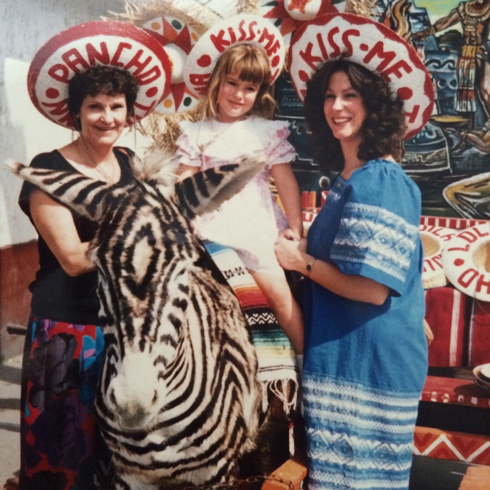 Vintage Mexico photo opp with a donkey painted like zebra