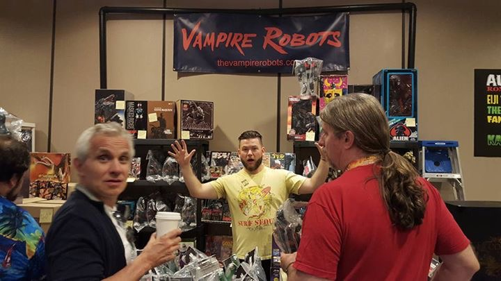 Here's the Vampire Robots set up saturday afternoon, with Master Controller Michael in the center, while award winning fantasy artist Bob Eggleton looks on...