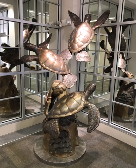 "Artist Paul Saviskas, Turtles Three original sculpture now on display at the Panama City Center for the Arts in historic downtown Panama City, Florida ""Na Honu Ekolu"" (The Turtles Three) is one-of-a-kind stainless steel sculpture and one of the largest pieces created by Paul Saviskas. Paul spent hours swimming with sea turtles at Punalu'u Black Sand Beach on the Big Island of Hawaii to capture the incredible detail and movement that you'll find in this sculpture.   The piece stands over 8 feet and weighs over 1300 pounds. It was painstakingly crafted over a 2-year period. 316 grade stainless steel was used to create this piece - it will withstand oceanfront and even submerged installations.   In addition to the wonderfully detailed sea turtles, the piece includes corals, starfish, pencil sea urchin and an arch.  Paul has been creating stainless steel art for over 30 years. His magnificent tropical floral designs that grace on gates, entrance ways, and railings found on many homes on Oahu, Maui, and the Big Island. His sculptures can be found at Hanauma Bay, Chinatown, Kapiolani Park, and the Zoo in Honolulu."