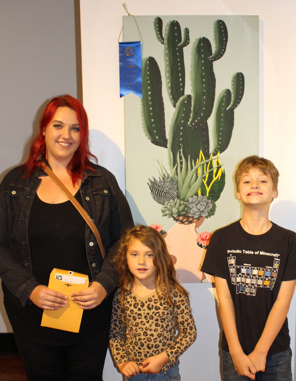 "Best Of Show winner Christence Taylor with her two children and the winning painting ""Guarded Girl"". Congratulations Ms. Taylor on your win."