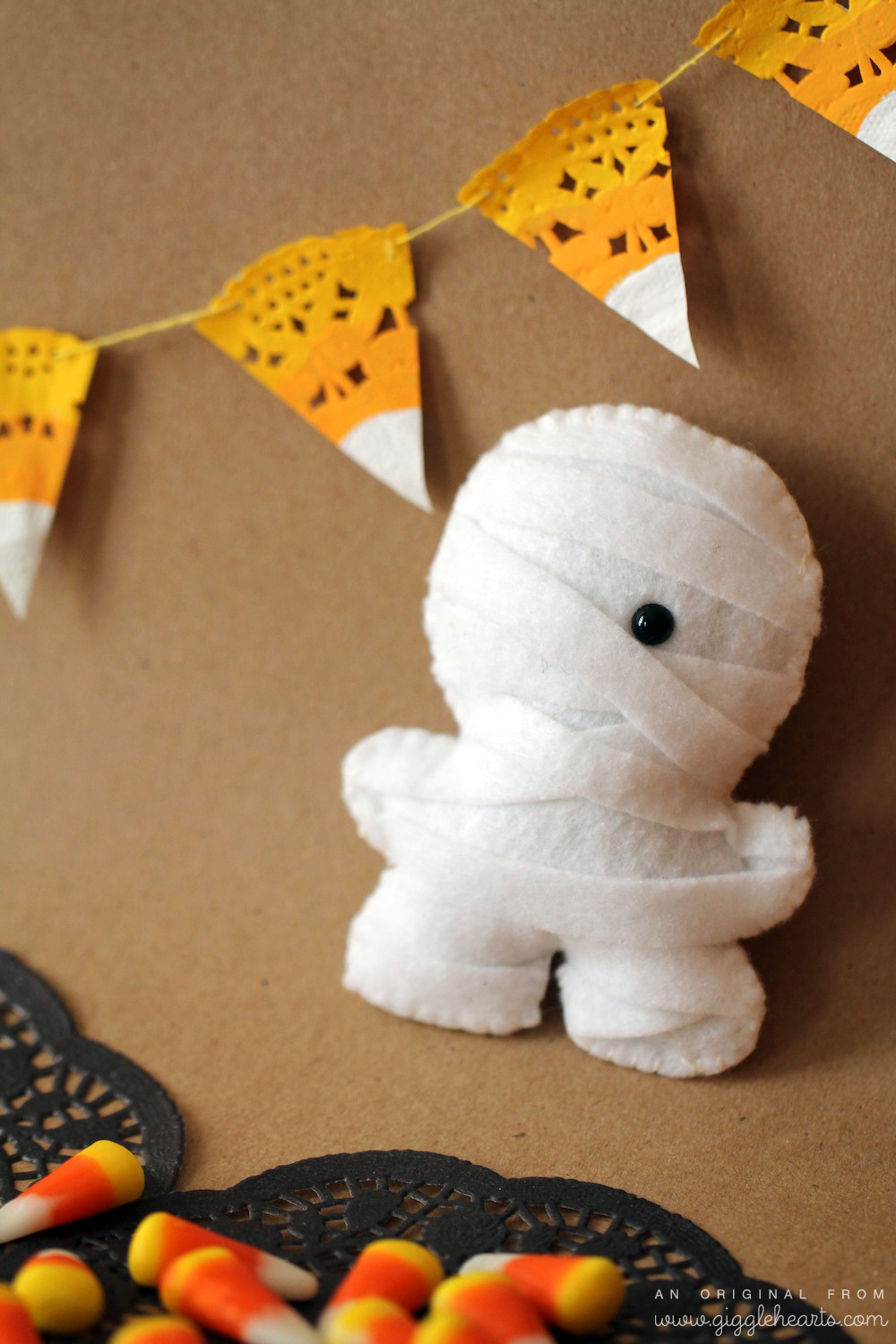 DIY Candy Corn Garland / shown with a Mummy Squatles / from www.GiggleHearts.com