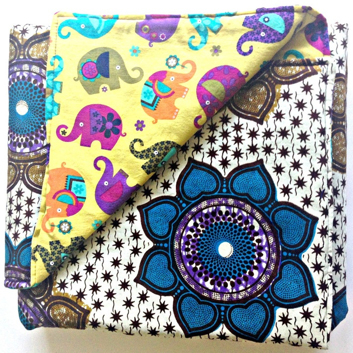 A reversible baby first blanket from Grace & Elie that's chock-full of colors to make tummy time twice as fun. Perfect for nap time, play time and trips to the park too / as seen on www.GiggleHearts.com