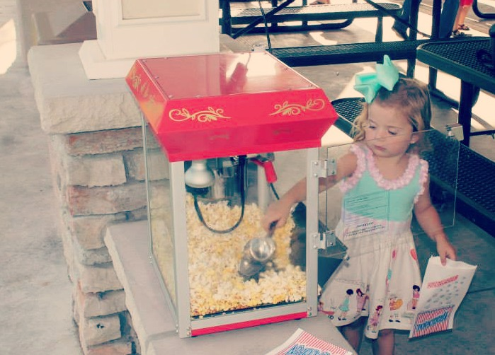 A vintage yet modern birthday party - complete with an old-fashioned popcorn popper / created by EAE Personalized Creations / as seen on www.GiggleHearts.com