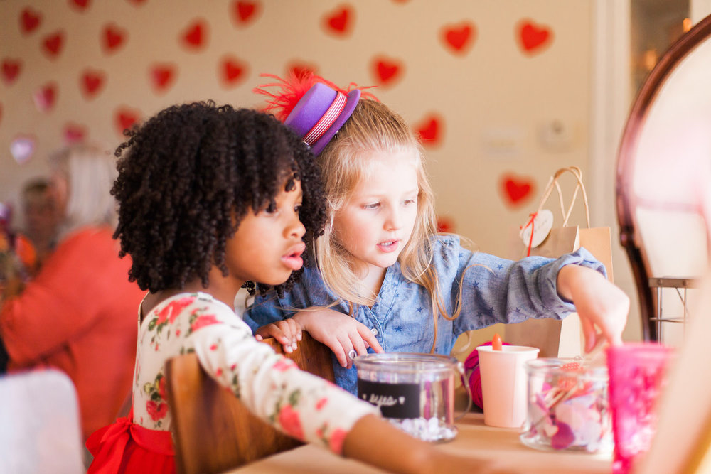 art-craft-valentines-day-party-Connie-Meinhardt-Photography-girls-at-table.jpg