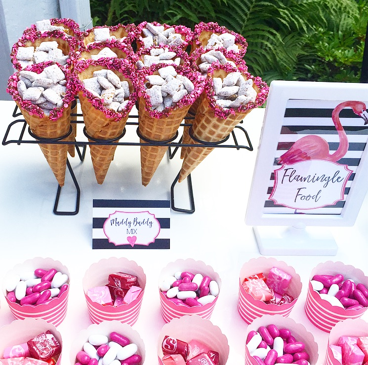 Pink Flamingo Food Station includes Pink Sprinkle Topped Waffle Cones holding Muddy Buddy Mix and Pink Candy in Pink Striped Paper Cups - for the Flamingo Outdoor Movie Party from Lori of Giggle Living - as seen on www.GiggleHearts.com
