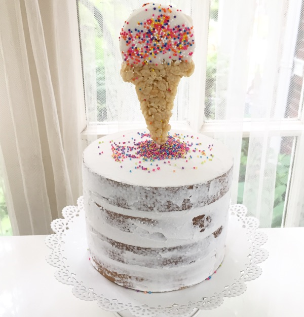 The most creative summer party cake topper - Rice Krispie ice cream cone with sprinkles from Bakers Party Shop. From Lori of Giggle Living - as seen on www.GiggleHearts.com