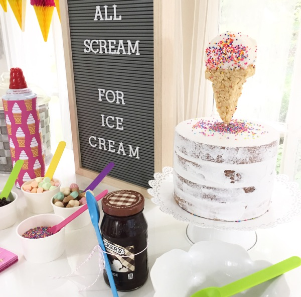 The ultimate summer party ice cream bar - complete with a letter board and an edible Rice Krispie ice cream cone cake topper with sprinkles from Bakers Party Shop. From Lori of Giggle Living - as seen on www.GiggleHearts.com