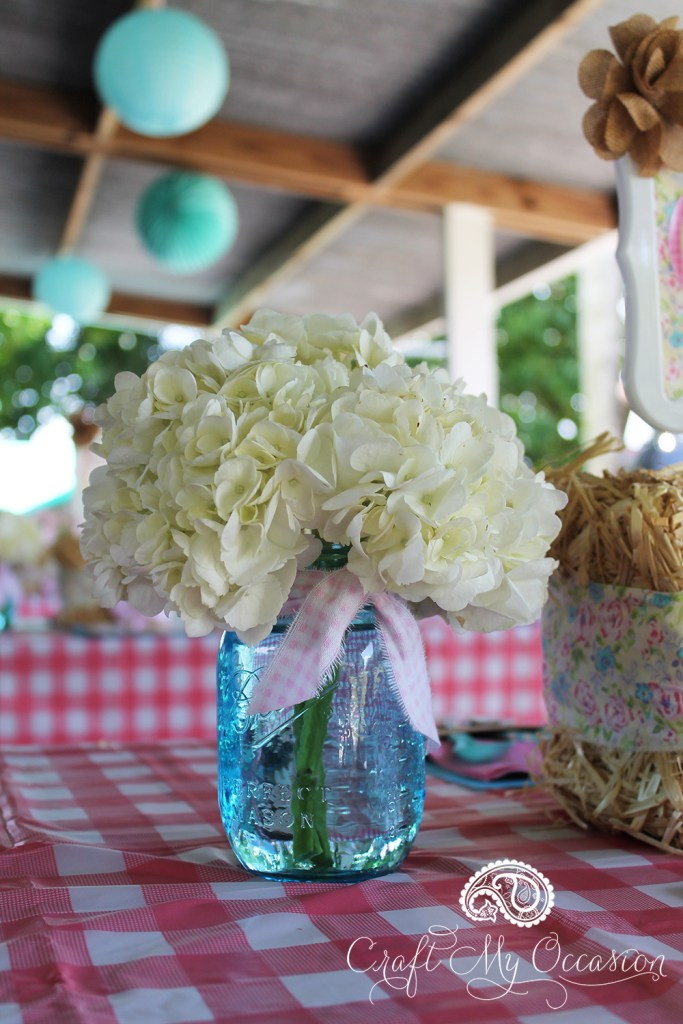 Fresh flowers in vintage mason jars are the perfect choice for centerpieces at farm themed parties. From the Pink Pony Birthday Party from Lynnette of Craft My Occasion - as seen in the Party Inspiration Gallery on www.GiggleHearts.com