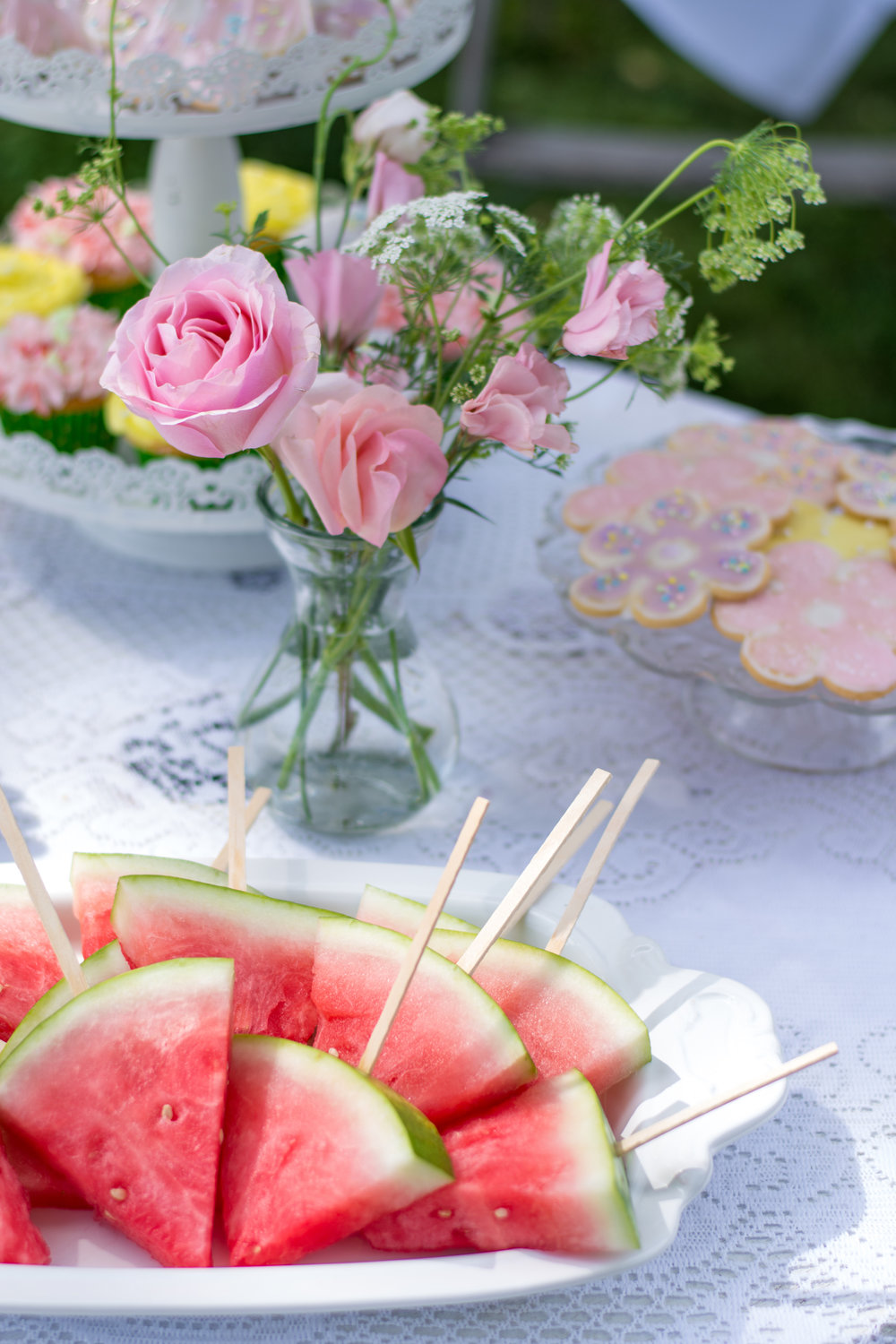 Vintage Garden Birthday Party Ideas for Tweens / serve watermelon slices on popsicle sticks for a refreshing snack / photo by Honeysuckle Rose Photography - as seen on www.GiggleHearts.com