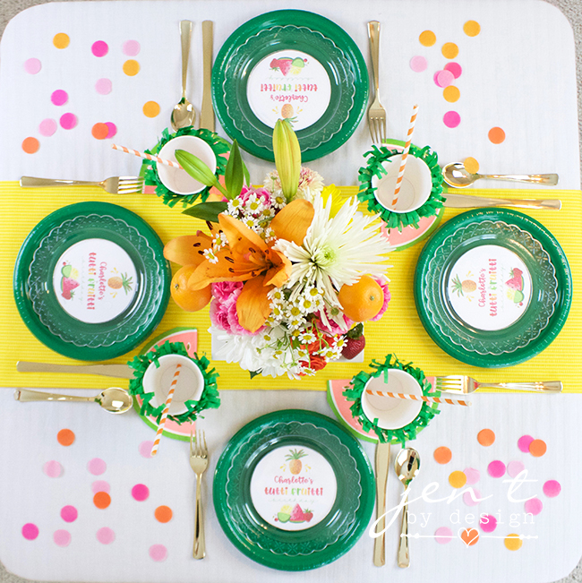 Colorful Tutti Fruitti Party Ideas / Tutti Fruitti Tablescape with green plates and a yellow table runner / from Jen T by design / as seen on www.GiggleHearts.com