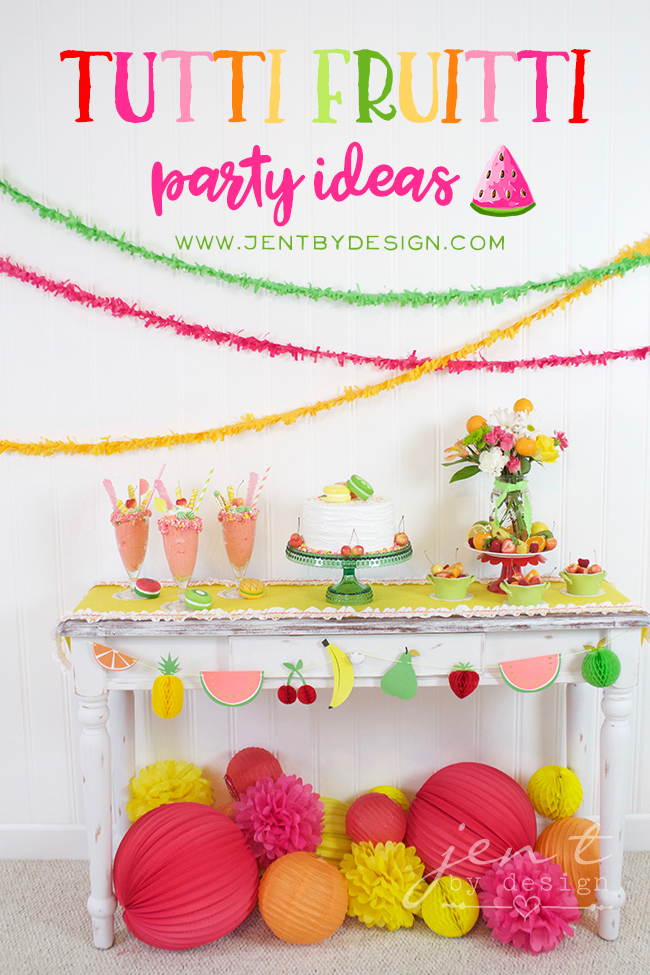 Colorful Tutti Fruitti Party Ideas from Jen T by design / loving the paper pom poms and paper lanterns with the fruit garland / as seen on www.GiggleHearts.com