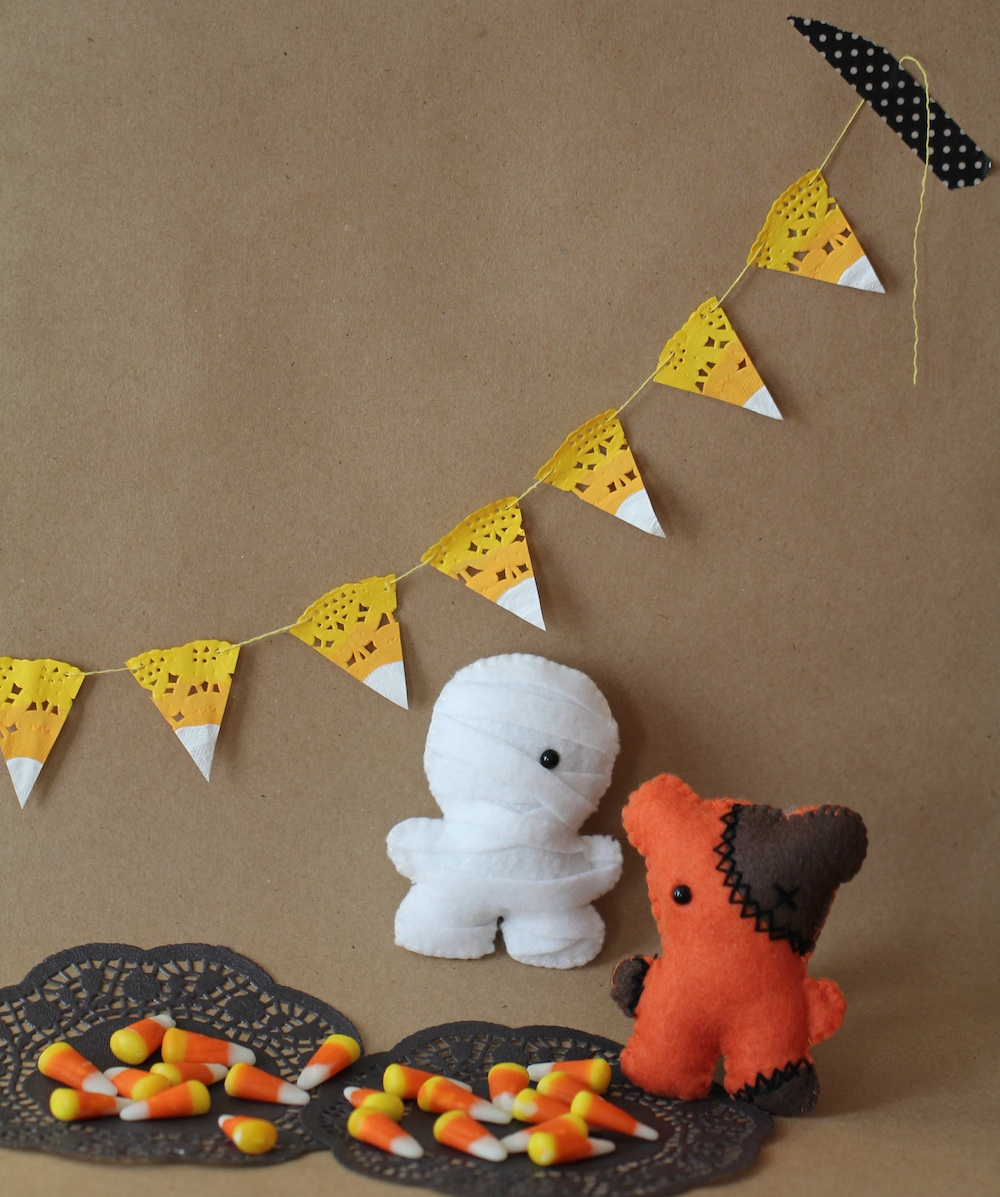 DIY Candy Corn Garland with Paper Doilies. Kids and Adults will love creating this fun Candy Corn Halloween Decoration - grab your paints and paper doilies and head on over to Giggle Hearts www.gigglehearts.com to see all the DIY Halloween Craft Projects #halloweencrafts #halloweencraftsforkids  #halloweenprintables  #fallcraftsforkids #fallcrafts