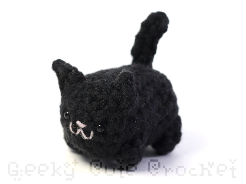 Such a sweet little crocheted black kitty for a halloween gift / black kitty crochet Amigurumi / handmade stuffed black halloween kitty / a fun halloween surprise tucked inside a Halloween Coffee Mug / as seen on Giggle Hearts www.gigglehearts.com