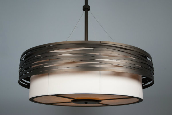 The outer drum of this fixture creates a bird's nest effect, which elevates the look of what would otherwise be a very simple drum fixture.