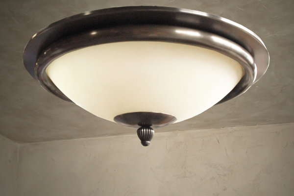 This traditional dome light is a simple flush-mount design that warm up a hallway or entryway.