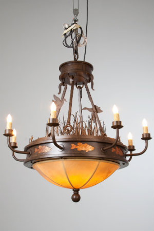 Hammerton's custom metalworking capabilities are on full display in this mountain-style chandelier, featuring duck, fish and grass motifs on an elaborate frame.