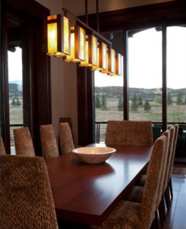 A contemporary dining fixture can perform more than one function, including ambient, accent and task lighting.