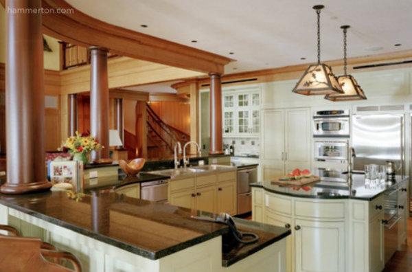 A hand-hewn Log & Timber light fixture with a rustic motif can have a surprising visual effect in a luxury kitchen full of stainless steel appliances.