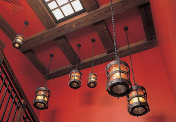 Staggering a cluster of sophisticated Chateau pendants can create a cohesive look in transitional stairways.