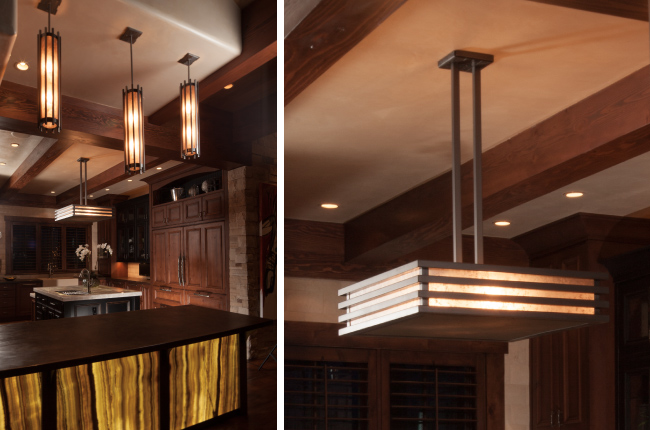 Above the kitchen island hangs a sleek, dark glass fixture, while three mica pendants with a premium Light Nickel finish light up a rich bar.