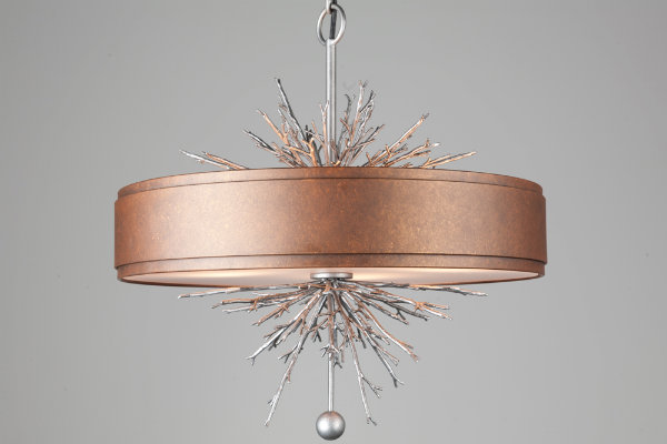 This contemporary lighting design makes a bold statement with a spectacular arrangement of silver branches that reflect the glow from the exquisite copper surround.