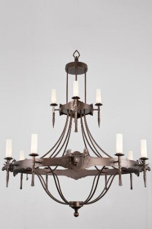 This unique light fixture exudes sophistication with its intricate design that could only be achieved by the hands of an exceptionally skilled metalworker.