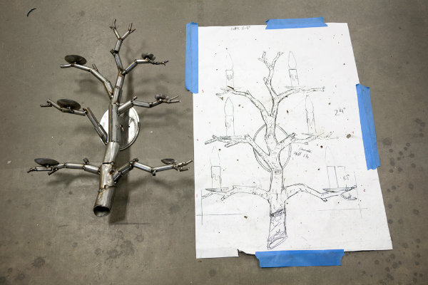 Also in production are custom sconces that will extend the organic branch aesthetic throughout the restaurant. Shown here is the rough structure of the wall sconce next to its original concept drawing.