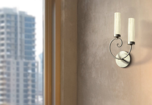 An understated Seriph sconce can give a traditional home an unexpected transitional twist.