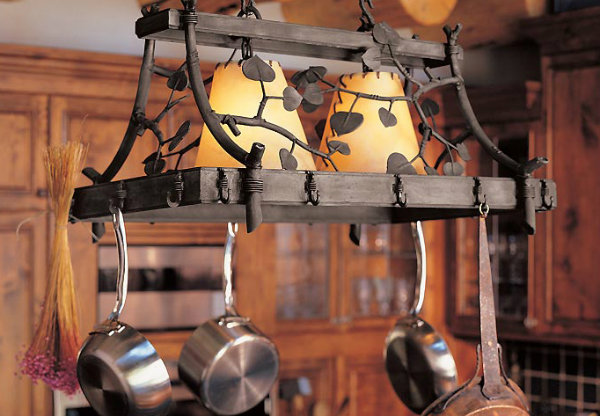 "A central kitchen chandelier can also do ""double duty"" as a functional pot rack."
