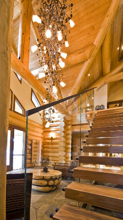 With cascading 'aspen branches' made from sculpted and textured steel, this dramatic chandelier perfectly complements the natural surroundings of this contemporary log home.