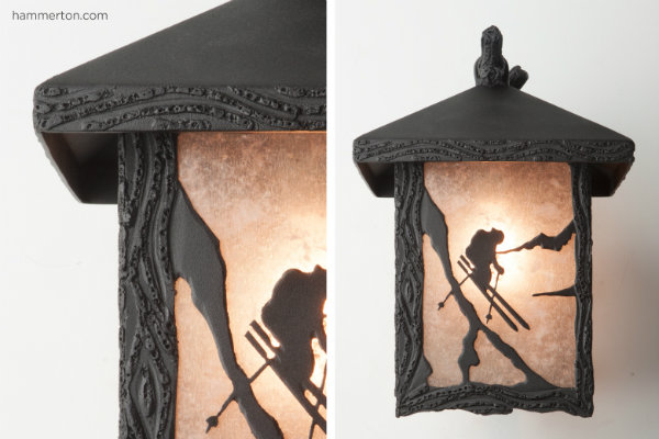 This Log & Timber outdoor sconce features a custom sports motif, a light mica lens material and a statuary bronze finish, and is crafted to withstand even the toughest winter climates.