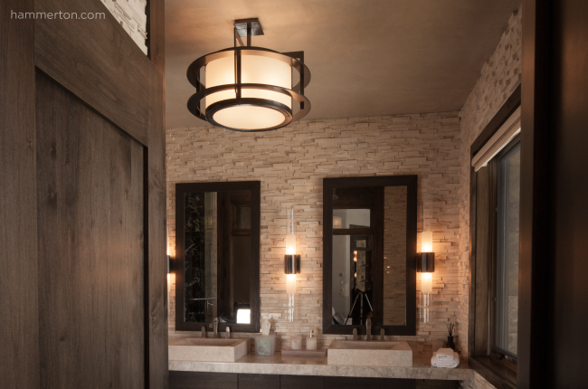 A row of sleek Bamboo glass sconces and a clean-lined glass and steel ceiling fixture give contemporary style to this master bath.