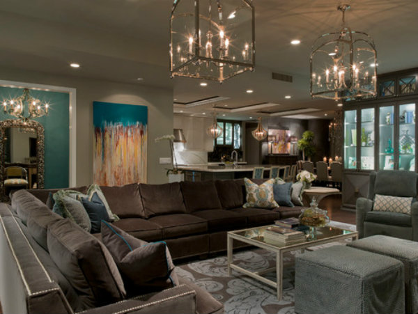 The dimmers around this living area creates a soothing and comforting effect, while the two main chandeliers above the seating area can be shut down when the area is not in use.