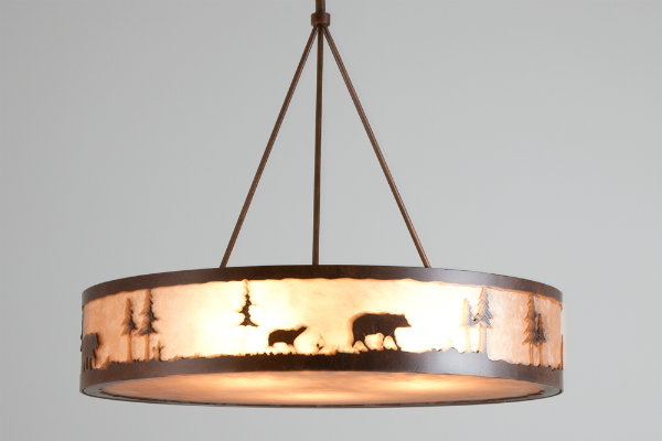 An unconventional custom interpretation of a drum light: this idyllic mountain scene featuring a bear and her cub jazzes up a contemporary fixture form.